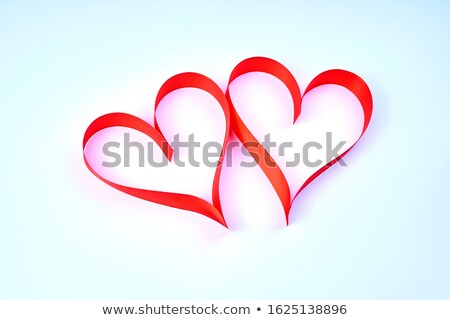 The concept of two lovers hearts lying on the white satin Stock photo © alekleks
