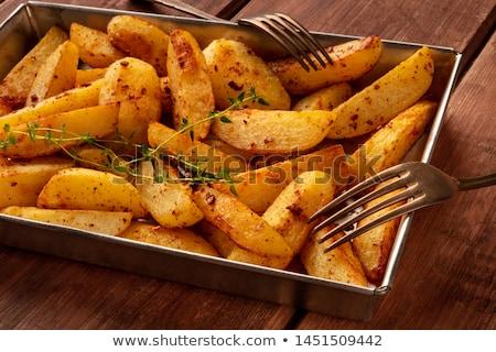 Stock photo: Oven baked potatoes