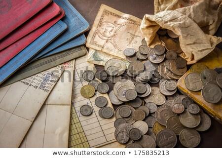 Régi könyv érmék fából készült asztal könyv fa Stock fotó © user_9834712