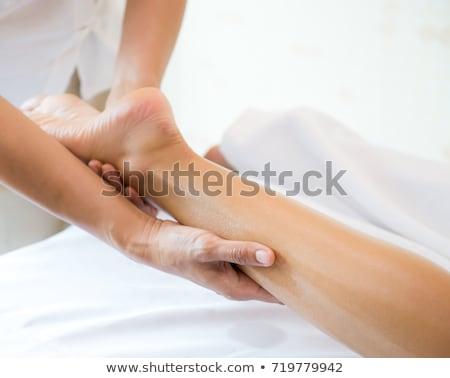Mujer pierna masaje primer plano trabajo Foto stock © AndreyPopov