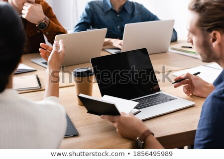Casual caucasian adult woman holding blank notepad paper Stock photo © stevanovicigor