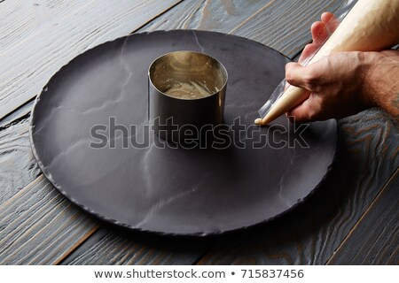 pannacotta preparation with chef hands stock photo © lunamarina