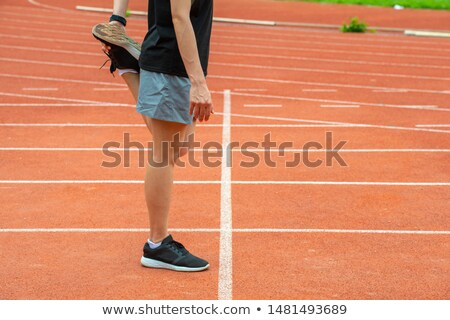 Woman performing stretching exercise on a race track Stock photo © wavebreak_media