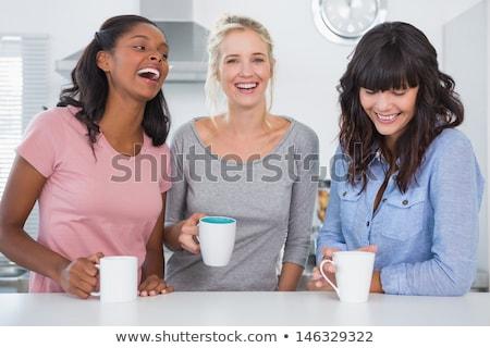 Kobieta kubek kawy kuchnia domu komputera Zdjęcia stock © wavebreak_media