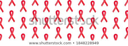 AIDS - Printed Diagnosis on Red Background. Stock photo © tashatuvango