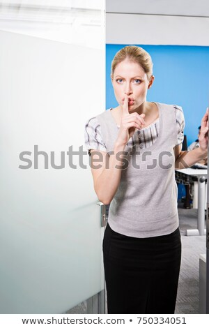 A female saying 'Shhh' outside an office Stock photo © IS2