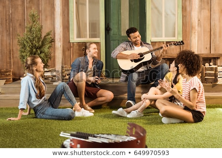 multicultural friends with guitar Stock photo © LightFieldStudios