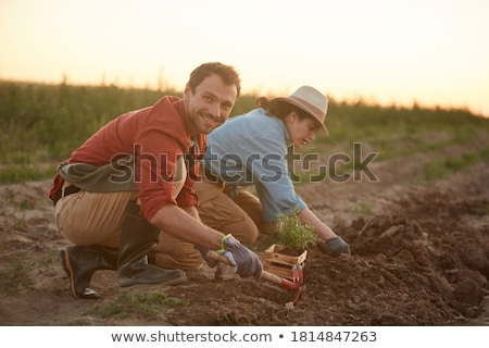 Young couple working in a garden Stock photo © IS2