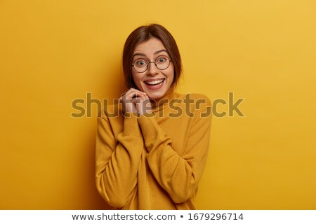 charming brunette girl in glasses and casual wear talking on mob stock photo © deandrobot