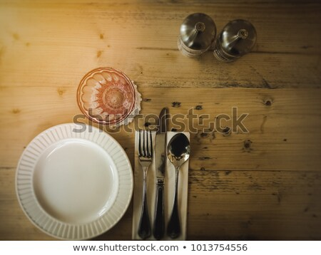 glasses and plates on the tables stock photo © dashapetrenko