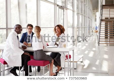 группа четыре врачи лобби медицинской больницу Сток-фото © IS2