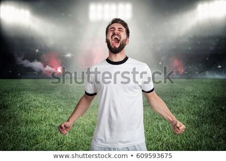Voetballer vieren overwinning succes jeugd mannelijke Stockfoto © wavebreak_media