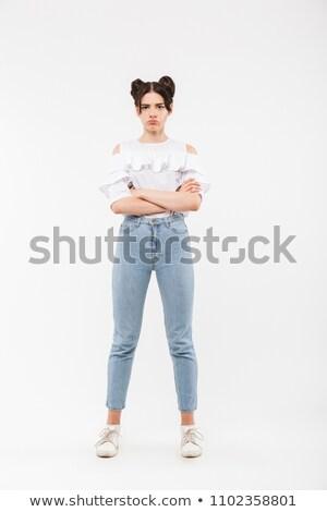 full length portrait of resented girl 20s having double buns hai stock photo © deandrobot
