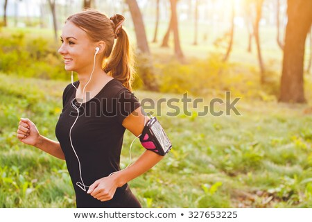 happy woman with fitness tracker and smartphone Stock photo © dolgachov