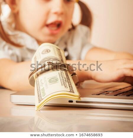 Megbilincselve kezek papír pénz fából készült kéz Stock fotó © OleksandrO