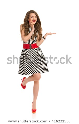 Front view of model in long dress looking at camera Stock photo © studiolucky