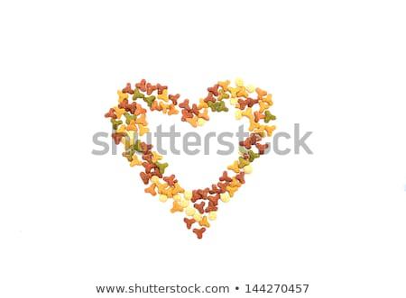 Secado gato alimentos galletas forma de corazón aislado Foto stock © sarahdoow