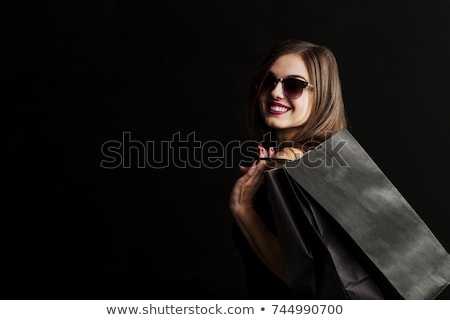 élégante brunette femme robe noire sexy mode Photo stock © bartekwardziak