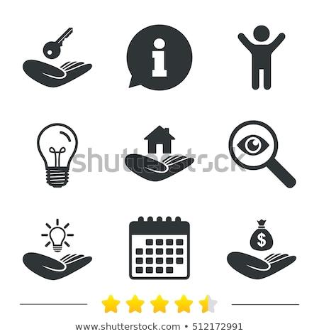 Hand holding light bulb with apps Stock photo © ra2studio
