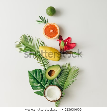 ripe tropical fruits and green leaves stock photo © artspace