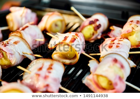 Grilled potato with bacon on gas grill .  Stock photo © Illia