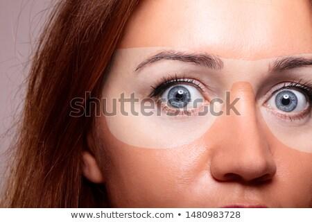 Woman with sunburn under sunglasses Stock photo © AndreyPopov
