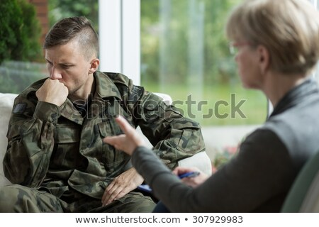doctor and military officer at psychotherapy treatment stock photo © andreypopov