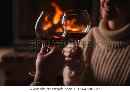 hands of couple clinking red wine glasses stock photo © dolgachov