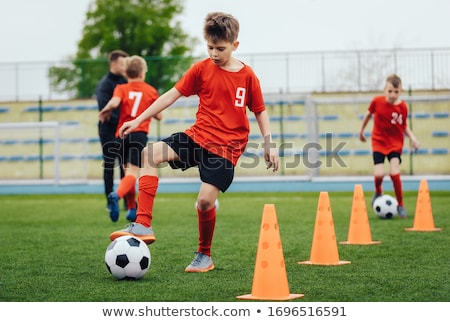 Football Training Dribbling Cone Drill. Young Boys of School  Stock photo © matimix