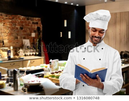happy male indian chef with cookbook at kitchen Stock photo © dolgachov