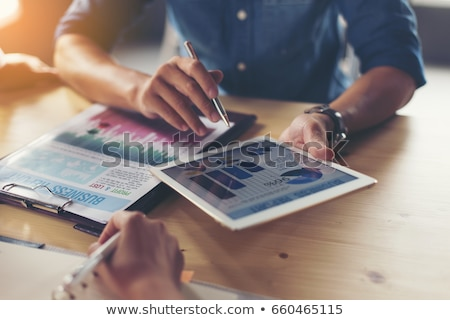 Businessman Analyzing The Graph On Laptop Stock photo © AndreyPopov