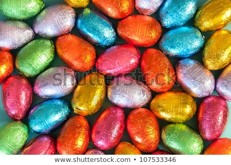close up of chocolate and colored easter eggs Stock photo © dolgachov