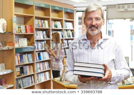 Ritratto maschio bookstore proprietario cliente libro Foto d'archivio © HighwayStarz