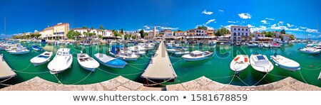 Krk. Town of Malinska harbor and turquoise waterfront panoramic  Stock photo © xbrchx