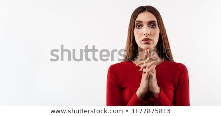 Thoughtful red haired lady holds chin, looks with contemplative expression at camera, thinks over fu Stock photo © vkstudio