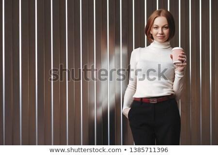 Mezza lunghezza shot piacevole guardando imprenditrice formale Foto d'archivio © vkstudio