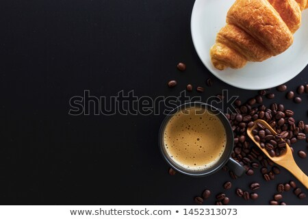 hot coffee cup with bread on the work space Stock photo © Suriyaphoto