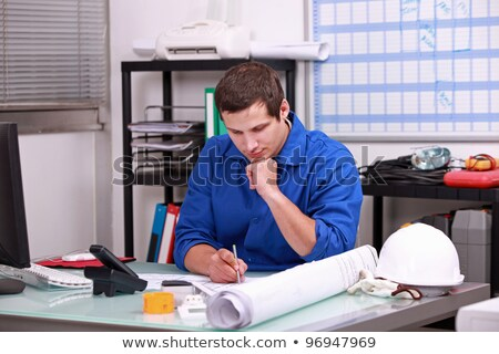 Manual worker completing paperwork Stock photo © photography33
