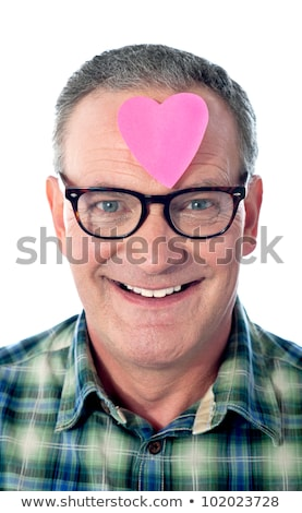 Handsome man with  heart shaped paper on his forehead Stock photo © stockyimages