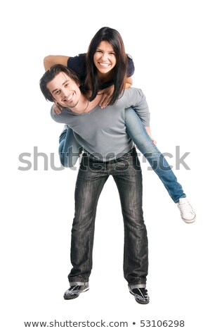 portrait of teenage couple piggybacking isolated in white stock photo © zurijeta