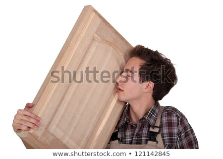 Man nuzzling a hand-crafted piece of wood Stock photo © photography33