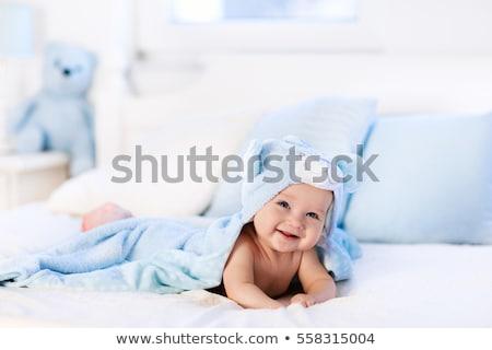baby with blue towel stock photo © dolgachov