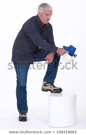 Mature man using paint sprayer Stock photo © photography33