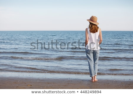 smiling woman in straw hat on sandy beach stock photo © dash