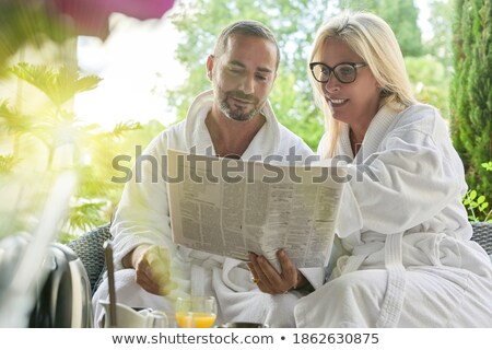 Couple reading the newspaper over breakfast Stock photo © photography33