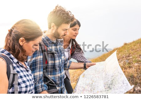 woman reading a map during a hike stock photo © photography33