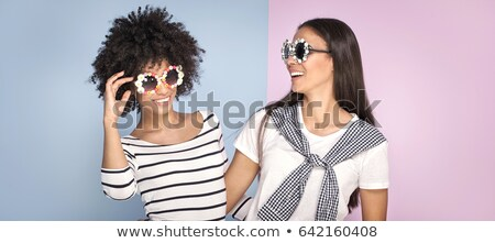 Studio shot of two pretty teenagers wearing colored sunglasses Stock photo © photography33