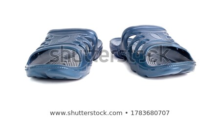 Two molded blue plastic slippers. Stock photo © justinb