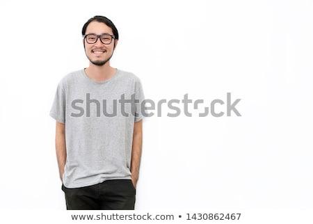 sorridente · jovem · nerd · menino · casual - foto stock © stockyimages