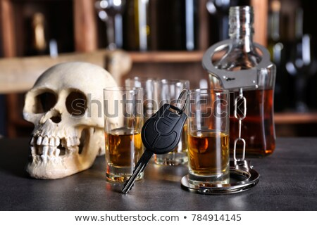 alcoholism to death with handcuff and bottle Stock photo © pterwort